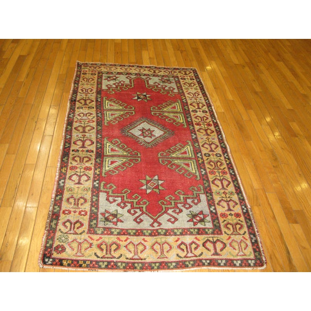This is a beautiful small vintage hand knotted tribal design rug. It is made with pure wool and cotton and rich natural...