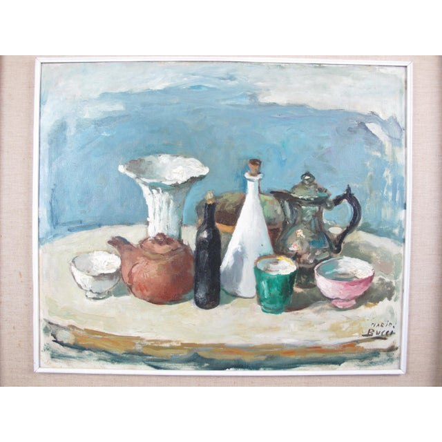 Mid century modern still life by Italian artist Mario Bucci (1903 - 1970), signed at lower right. Depicting a series of...