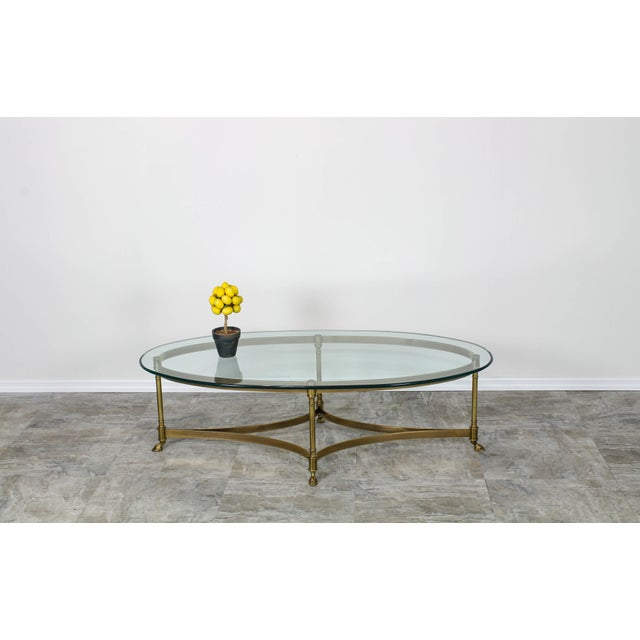 Unique vintage Hollywood regency solid brass coffee table with hoof foot and glass toptable by Labarge with original...