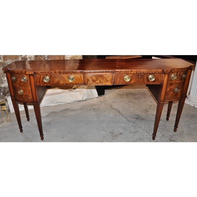 Period Georgian Mahogany sideboard of great length but very shallow depth. Tapered legs, Hepplewhite. With wine drawer