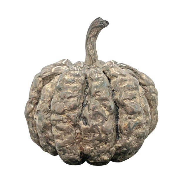 A wonderfully whimsical and absolutely unnecessary silver-plated, cast from life, pumpkin table ornament, because why not?