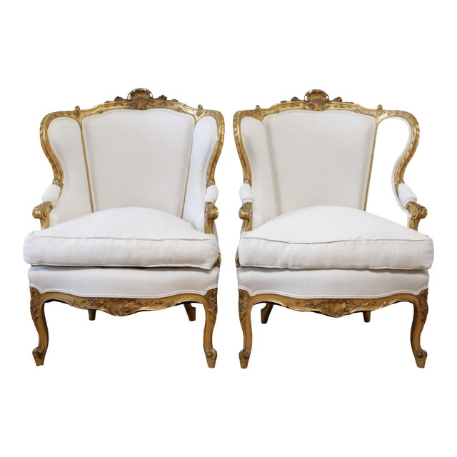 Pair of Antique Giltwood Linen Upholstered Bergère Chairs For Sale
