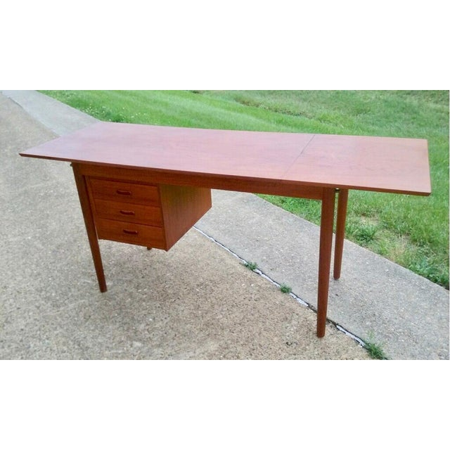Circa 1960 A teak extendable student desk designed by Arne Vodder for H. Sigh & Sons Mobelfabrik with a drop leaf...