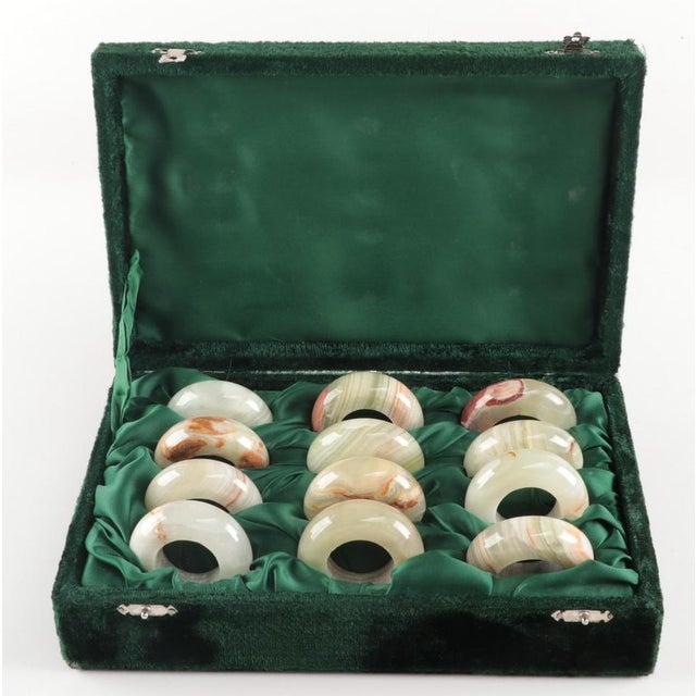 Fabulous set of a DOZEN vintage onyx napkin rings in lovely green velvet presentation case. Each napkin ring measures...