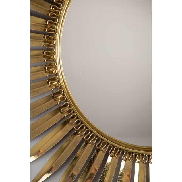Circa 1960s gold tone metal framed sunburst mirror found in Italy. Center mirror is convex. Minor scattered surface wear...