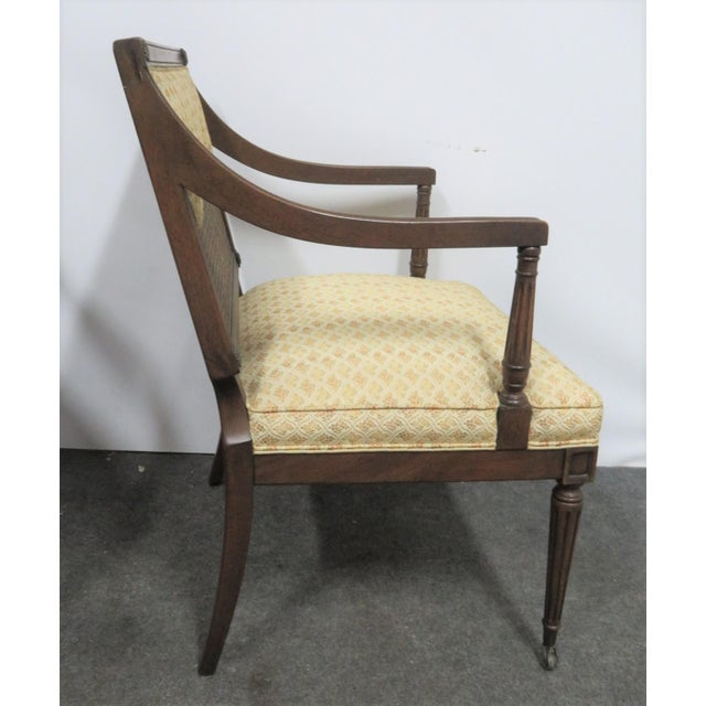 Pair Louis XVI Style Caned back upholstered Armchairs, caned back with scalloped upholstery, upholstered seat.