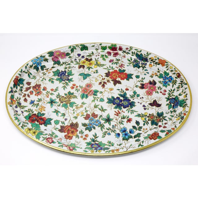 A vintage, large metal tray, decorated with a colorful printed floral pattern and gold accents. Good vintage condition....