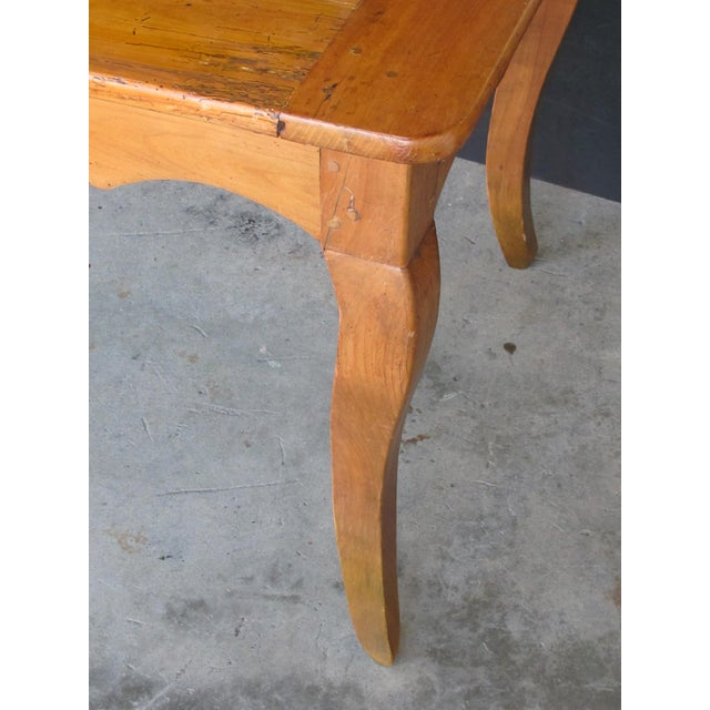 French A Handsome, Rustic and Sturdy French Country Cherry Wood Farm Table With Drawer and Slide For Sale - Image 3 of 7
