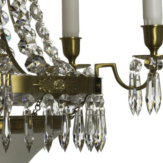 A beautiful crystal chandelier with a frame of oxidized real brass, pinned with full cut drop crystal and chains of...