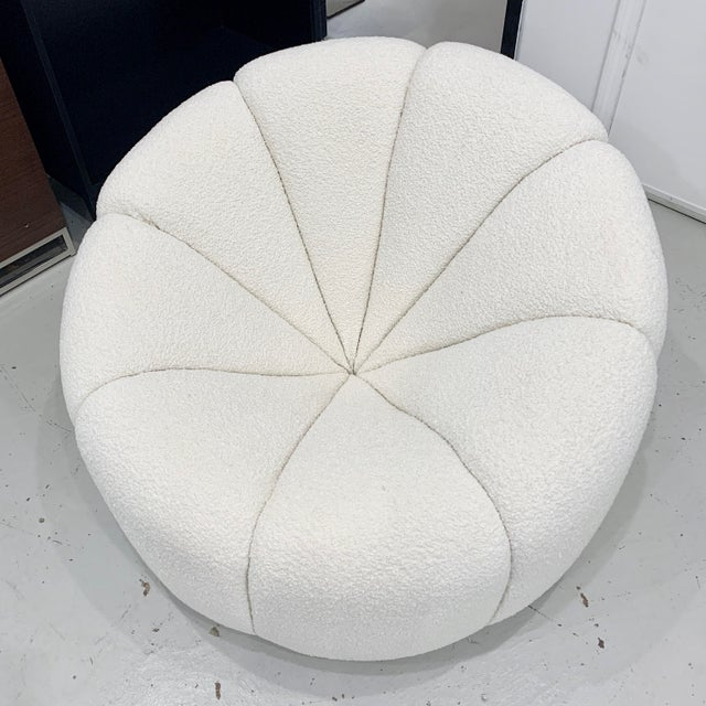 This tub chair features the channeled details throughout its framed. Recently upholstered in an off white boucle alpaca...