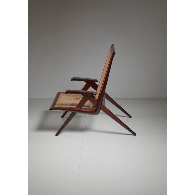 Mid-Century Modern Brazilian walnut armchair with woven cane seating For Sale - Image 3 of 6
