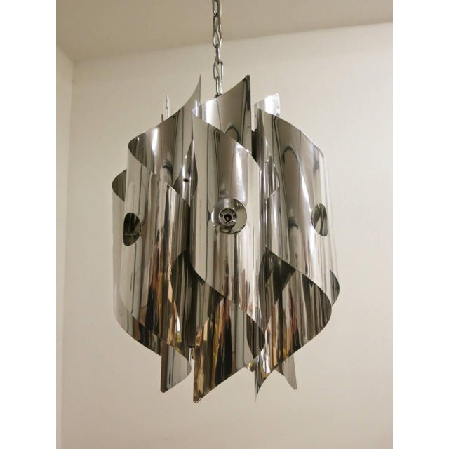 Vintage Italian chandelier or pendant with spiraled chrome design, by Sciolari. / Made in italy in the 1970's. 8 lights /...