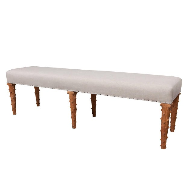This bench was designed and produced using the skills of master craftsmen. It has six hand-carved, tapered tree branch...