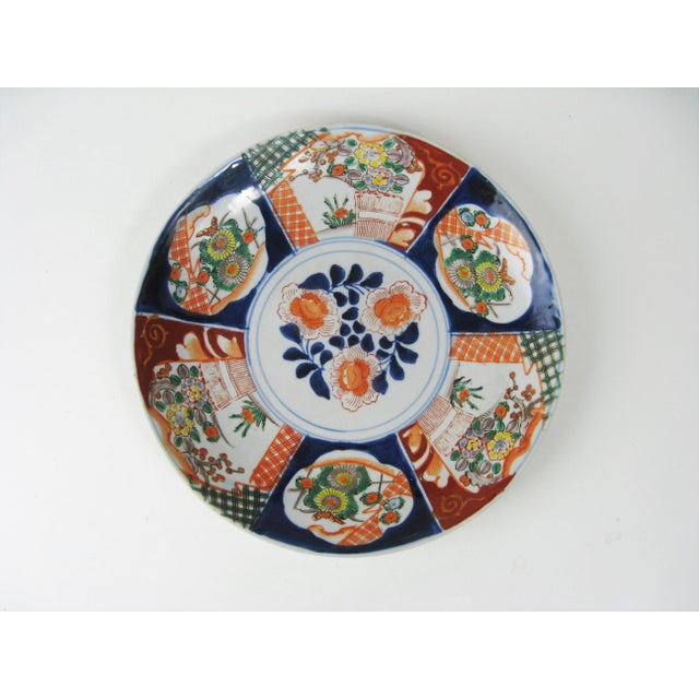 A striking hand-painted imari masterpiece from the late 1800s. Remarkably well cared-for. A center motif of flowers and...