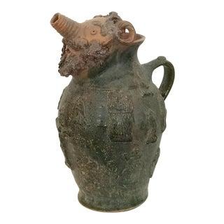 Face Motif Pottery Jug
