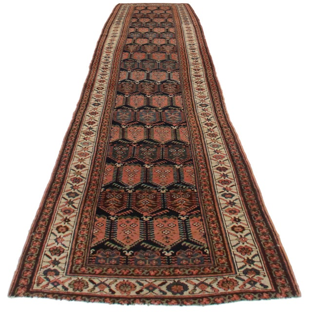 Offered is this antique Persian Kurdish runner. Hand-knotted from wool. Lovely all over geometric design. Beautiful color...