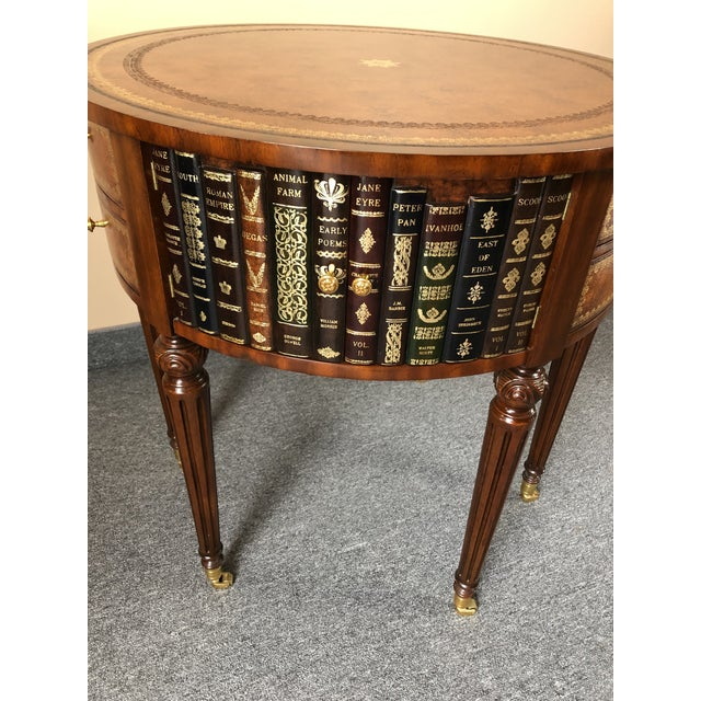 Stylish round side or end table having tooled leather top and trompe l'oeil leather books around the body with 6 drawers...