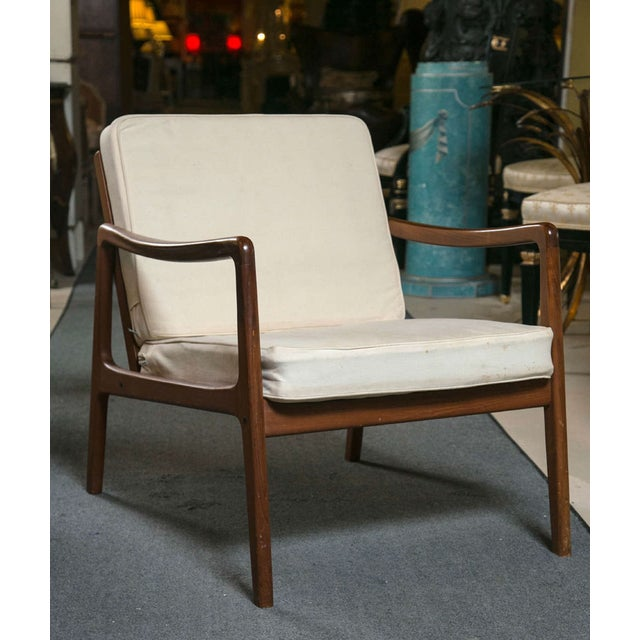 Designed by Ole Wanscher for France & Sons, a beautiful teak lounge chair, streamlined form, cushioned seat. This chair...