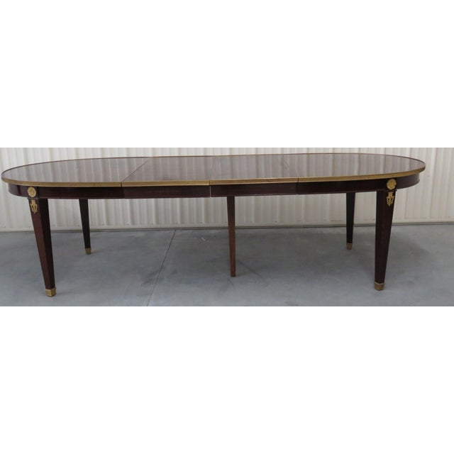 """Regency style bronze mounted dining table with 2 20"""" leaves and a drop down support leg."""
