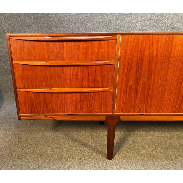 """Here is a beautiful british mid century teak """"Dunottar"""" sideboard designed by Tom Robertson and manufactured in Scotland..."""