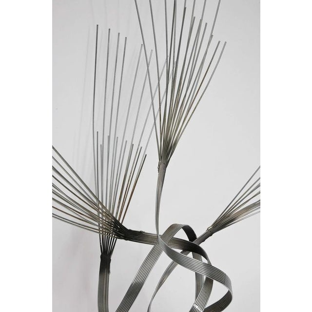 A large and spirited tabletop wire sculpture by Curtis Jere on solid onyx base. Signed and dated, 1978.