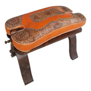 Moroccan Camel Saddle Orange Leather Cushion Wooden Base For Sale