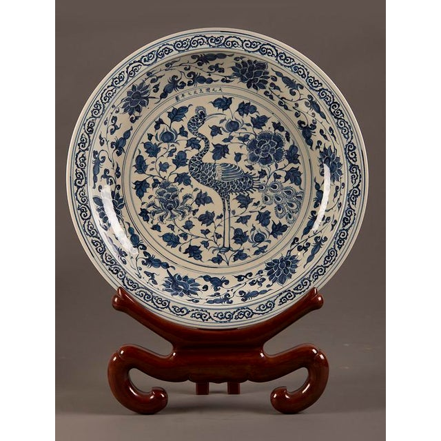 A grand scale vintage Chinese blue and white glazed bowl. The striking image of the crane with its distinctive stance...