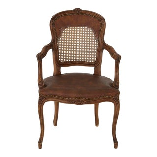 French Provencal Louis XV Style Armchair With Embossed Faux Leather and Caned Back For Sale