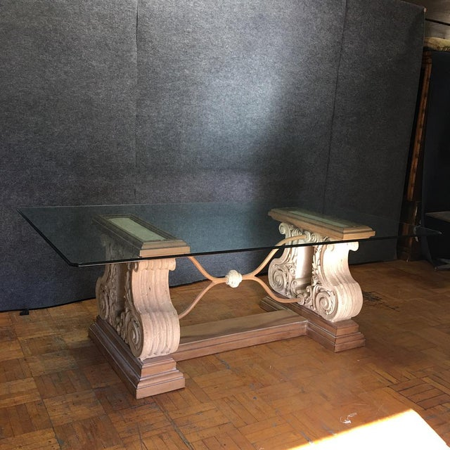 This is a double stone and iron pedestal base dining table with a beveled glass top in a classic Italian Rococo style. The...