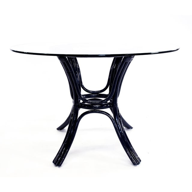 Vintage bamboo table newly finished in a deep navy with a round glass top.
