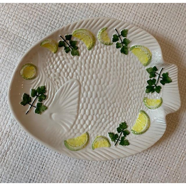 Fantastic set of 6 majolica Bassano Fish plates from Italy. White plates decorated with yellow lemons and green parsley....