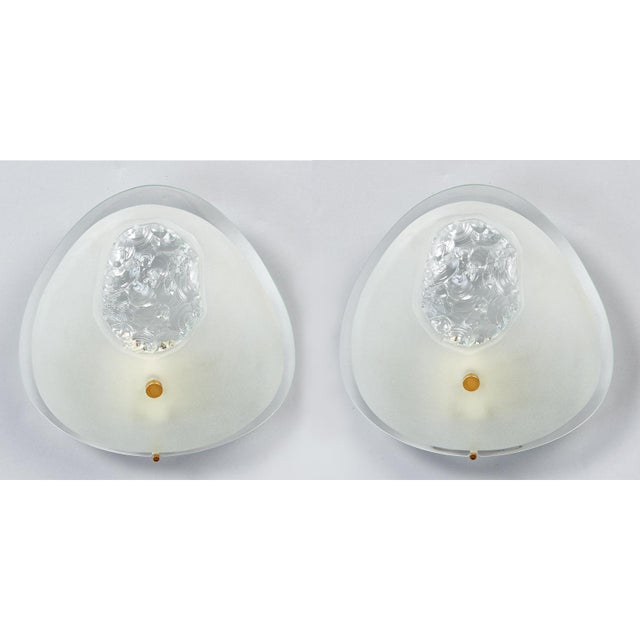 Max Ingrand (1908 - 1969) A beautiful and unusual pair of deep-beveled oval sconces in contrasting polished and frosted...