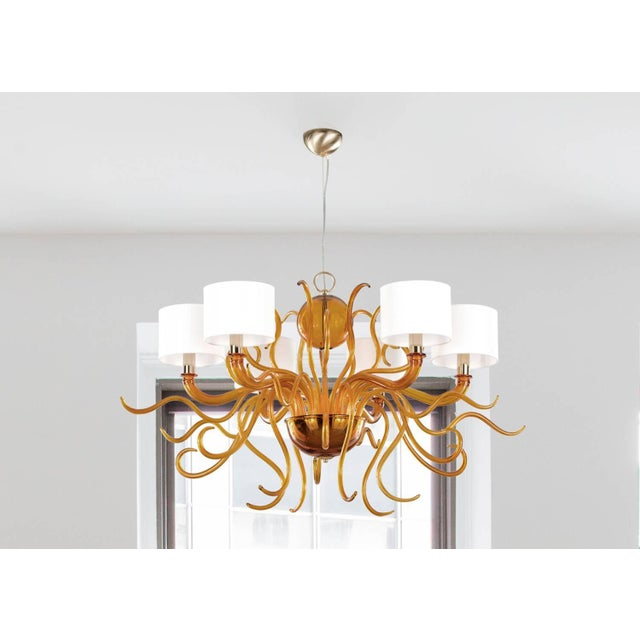 Italian modern Venetian chandelier with dark amber Murano glasses blown into stylish curved arms and mounted white cotton...