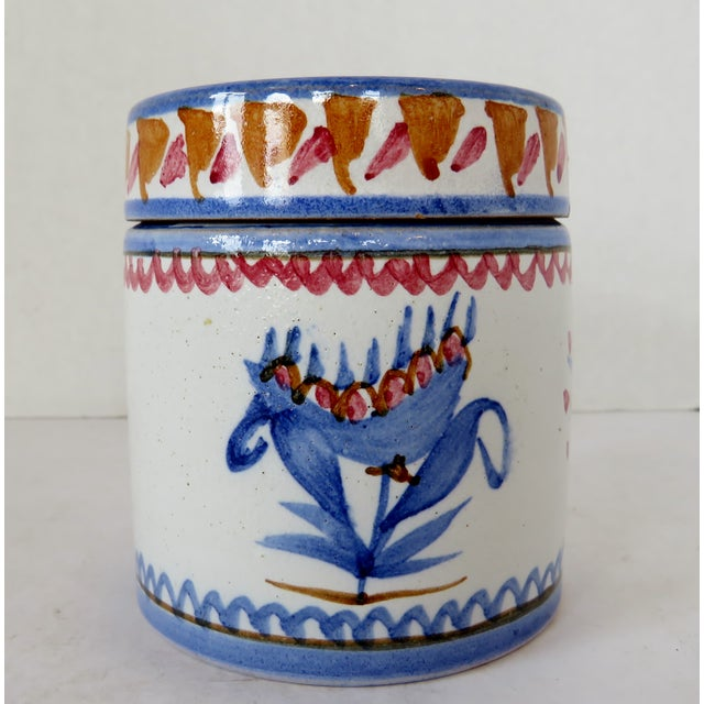 Hand-painted Venetian Italian lidded container in cylinder shape, with blue and burnt orange decoration on white glaze.