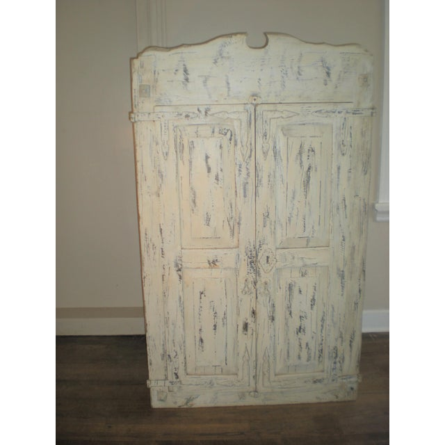 This piece is a French country armoire or cabinet. It came from a plantation in Natchez, Mississippi. It comes with two...