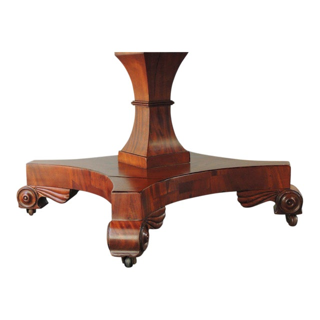 This large scale library table was made in England in the early half of the 19th century. This table is mahogany and has a...