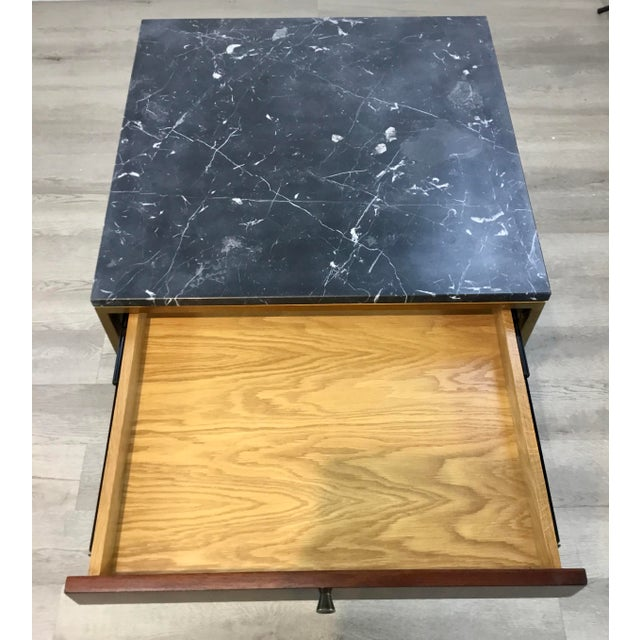 Mid-century modern black marble and walnut finished wood Copeland end table, antique brass finished frame, one drawer and...