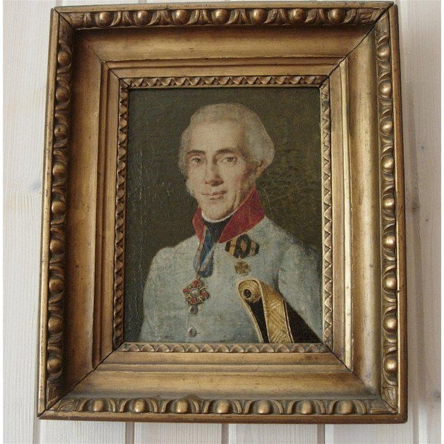 19th century portrait of a french officer in a giltwood frame.