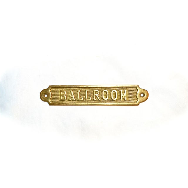 A vintage brass plaque reading 'Ballroom' for a door or wall. Weighty and solid. Pre-made hole for mounting on each end....