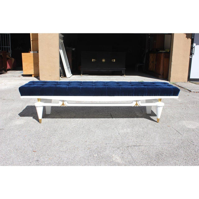 Monumental French Art Deco snow white lacquered sitting benches with beautiful hardware , circa 1940s. Newly upholstered...