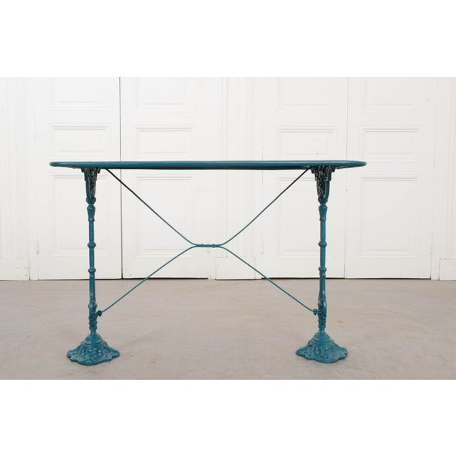 A charming vintage painted cast-iron and sheet metal bistro table, c. 1910, from France. The rectangular sheet-metal...