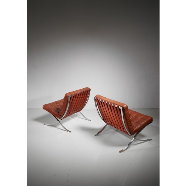 A pair of original Barcelona chairs in perfect condition and with label. Designed by Ludwig Mies van der Rohe for the...
