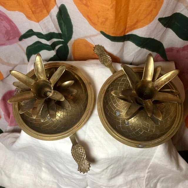 """Set of two vintage brass pineapple candle holders. Features diamond """"pineapple skin"""" pattern on the base, and """"pineapple..."""
