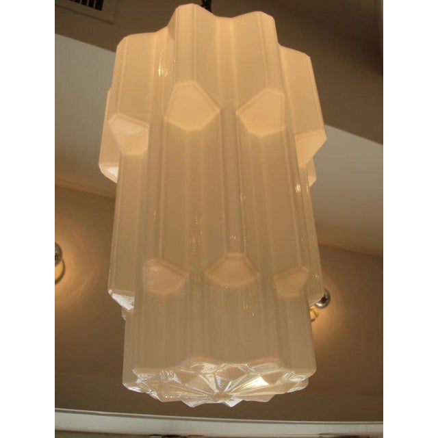 Wonderful Art Deco era milk glass in machine/industrial design form. Gives warm light and a timeless design feel. These...