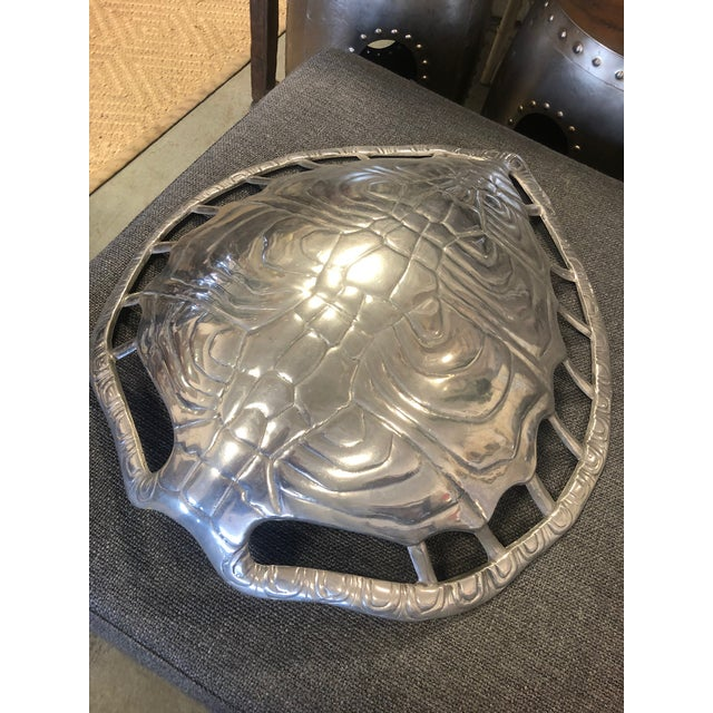 Arthur Court aluminum turtle shell sconce. Pierced opening surround the shell to let in as well as frame the piece....