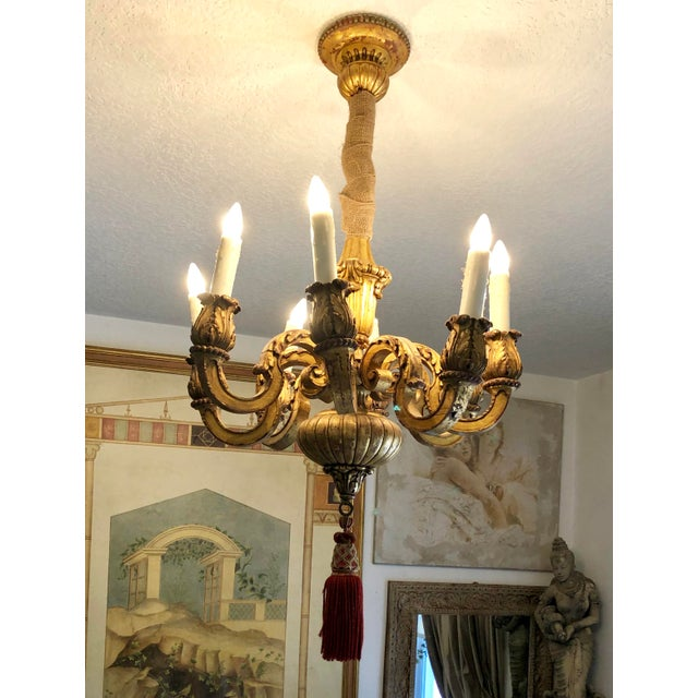 Mid 19th Century Italian Gilt Wood Chandelier with 8 arms. Nicely Carved with gadroons, scrolls & leaves. Original Gilt...