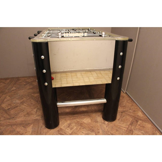 This spectacular and very unique foosball table made in 1970s features all Lucite, mirror polished aluminum sides, black...