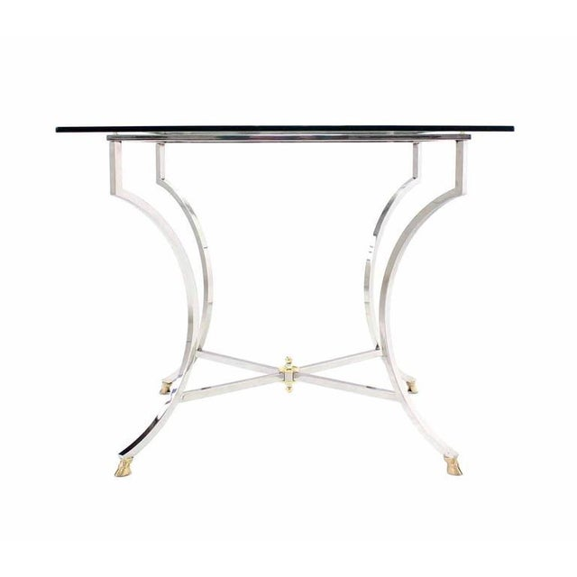 Brass hoof feet stainless steel base thick glass top game table.