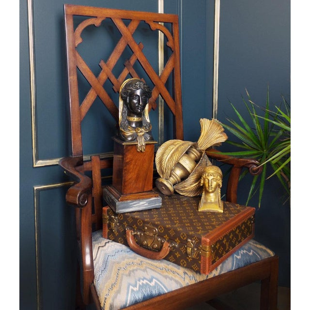 A Chippendale style open arm chair having an open fretwork back and a slip seat. Additional finishes available....