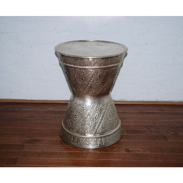 This drum table features hand-hammered brass with an oxidized silver finish. Made in India, this flexible piece can be...